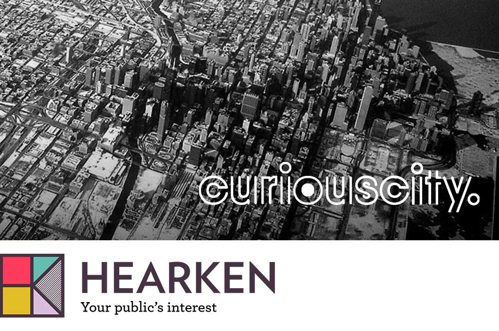 Black and white aerial photo of Chicago with the Curious City logo in the lower right corner; below that is the full-color logo for Hearken
