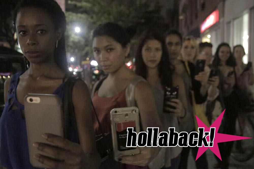 Photo showing a row of young women holding cell phones displaying the hollaback! mobile app.